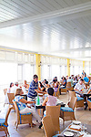 The Atlantis Hotel, Tent Bay, St. Joseph, Barbados.  Sunday Brunch is always packed with locals and tourists alike.  Owner Andrew Warden (in the blue and white striped shirt) pours wine for some of the guests.