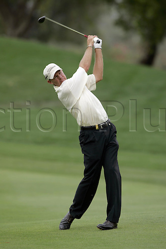 5 March 2005: South African golfer JAMES KINGSTON (RSA) plays a fairway wood during round three of the Dubai Desert Classic held on the Majlis Course at the Emirates Golf Club, Dubai, United Arab Emirates. Photo: Neil Tingle/Action Plus..050305 male man men golf golfer golfers