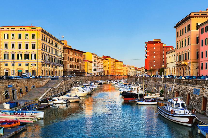 Charming boat lined canal, Livorno, Tuscany, Italy.