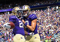 Jacob Eason congratulates Richard Newton on his first quarter touchdown.