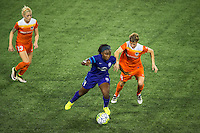 Orlando, FL - Thursday June 23, 2016: Jamia Fields, Rebecca Moros during a regular season National Women's Soccer League (NWSL) match between the Orlando Pride and the Houston Dash at Camping World Stadium.