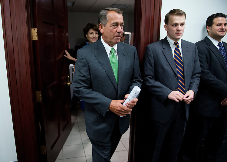 UNITED STATES - SEPTEMBER 26: Speaker John Boehner, R-Ohio, leaves a meeting of the Republican caucus in the Capitol to conduct a news conference where he mainly addressed the debt ceiling debate. (Photo By Tom Williams/CQ Roll Call)