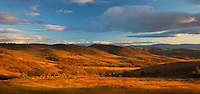Siskiyou County, CA<br /> Evening light on Willow Hill illuminates the rolling hills and clearing storm clouds with distant views of Little Shasta Valley