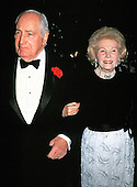 Former Ambassador Walter Annenberg, left, and his wife, Leonore, right, arrive at the White House in Washington, DC for the State Dinner hosted by United States President Ronald Reagan and first lady Nancy Reagan honoring Prime Minister Margaret Thatcher of Great Britain at the White House in Washington, DC on November 16, 1988.<br /> Credit: Ron Sachs / CNP