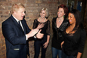London Mayor Boris Johnson with girl group the Lorelles. Busking at London Bridge Station. Rhythm of London 2011, Busking Underground competition is underway and the hunt is on to find London's most talented young musicians.
