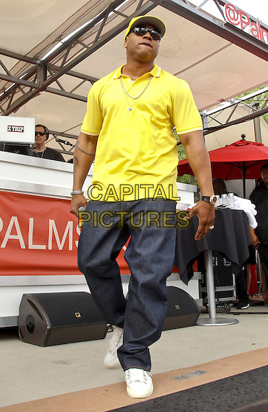 LL Cool J (James Todd Smith)<br /> performs at 'Ditch Saturdays' at Ditch Pool &amp; Dayclub at Palms Casino Resort, Las Vegas, Nevada, USA 31st August 2013.<br /> on stage in concert live gig performance performing music full length yellow t-shirt baseball cap hat sunglasses shades jeans denim   <br /> CAP/ADM/MJT<br /> &copy; MJT/AdMedia/Capital Pictures