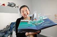 UAA Professor of Art Education Dr. Herminia Din in the Kimura Gallery with her latest project focusing on plastic pollution, Our Plastic Ocean, Our Clean Ocean: A Popup Book.