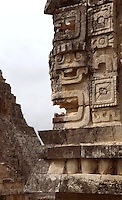 The Nunnery Quadrangle, Eastern Edifice, detail of the corner of the frieze with masks of Chaac, God of the rain, Temple of the Magician or House of the Dwarf in the distance, 900-1000 AD, Puuc architecture, Uxmal late classical Mayan site, Yucatan, Mexico Picture by Manuel Cohen