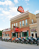 USA, Wyoming, motorcycles in a row parked outside Irma Restaurant and Hotel, Cody