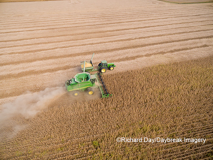 63801-08802 Soybean Harvest, John Deere combine unloading soybeans into grain cart while harvesting - aerial Marion Co. IL