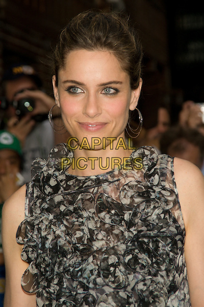 "AMANDA PEET.(promoting ""The X-Files: I Want To Believe"").Appearance on the ""Late Show with David Letterman"" at the Ed Sullivan Theater, New York, NY, USA..July 22nd, 2008.headshot portrait black white grey gray ruffled ruffles frills silver hoop earrings .CAP/LNC.©TOM/LNC/Capital Pictures."