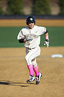 Stuart Fairchild (4) of the Wake Forest Demon Deacons hustles towards third base against the Virginia Tech Hokies at Wake Forest Baseball Park on March 7, 2015 in Winston-Salem, North Carolina.  The Hokies defeated the Demon Deacons 12-7 in game one of a double-header.   (Brian Westerholt/Four Seam Images)