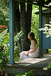 Young woman sitting on porch
