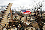 BREEZY POINT, NEW YORK-NOVEMBER 01: Fire destroyed over a 100 homes in this Queens neighborhood during Hurricane Sandy November 1, 2012. The super storm has caused over 20 billion USD in damages.