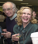 Tony Scaduto, Rosemary Skapley, at champagne get together of Newsday staff in the City room to toast the departure of colleagues on Friday March 1, 2002. (Newsday photo by Jim Peppler).