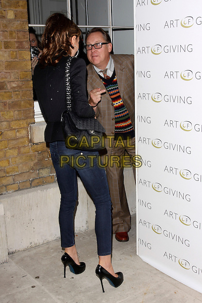 TARA PALMER TOMKINSON & VIC REEVES .at The Art Of Giving - Private View, Saatchi Gallery, London, England, UK, October 7th 2010..full length skinny jeans black patent platform shoes heels blazer jacket white top bag chanel  back rear behind funny  brown suit .CAP/AH.©Adam Houghton/Capital Pictures.