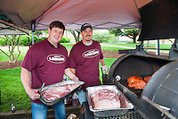 "Tyler Anderson, left, and Chris Williams with Mississippi Land Bank spent Friday morning readying their Boston butts and shoulders for the annual Super Bulldog Weekend pig cooking contest near the university's Howell Building. The Mississippi Pork Producers Association's ""Sampling of the Grill"" begins at 4 p.m. Friday and 11 a.m. Saturday. Judging takes place Saturday from 9 a.m.-noon. Click here to view a complete schedule of 2016 Super Bulldog Weekend events. Fans are encouraged to use the hashtag #SBW16 throughout the weekend on social media.(photo by Russ Houston / © Mississippi State University)"