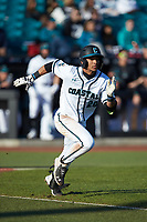 Eric Brown (20) of the Coastal Carolina Chanticleers hustles down the first base line against the Illinois Fighting Illini at Springs Brooks Stadium on February 22, 2020 in Conway, South Carolina. The Fighting Illini defeated the Chanticleers 5-2. (Brian Westerholt/Four Seam Images)