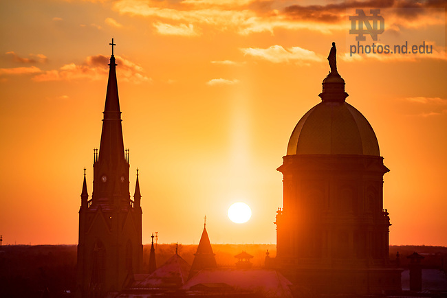 December 7, 2017; The sun sets between the Basilica and the Dome. (Photo by Matt Cashore/University of Notre Dame)