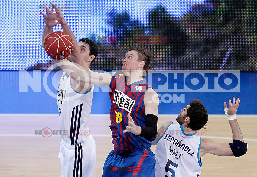 Real Madrid's Nikola Mirotic (l) and Rudy Fernandez (r) and FC Barcelona Regal's CJ Wallace (c) during Spanish Basketball King's Cup match.February 07,2013. (ALTERPHOTOS/Acero) /Nortephoto