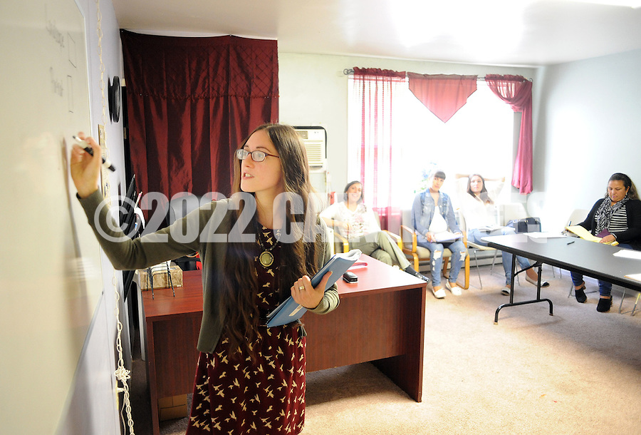 Meg Eubanks, executive director writes on the board while teaching a lesson during a Welcoming The Stranger english as a second language class Thursday October 8, 2015 in Warminster, Pennsylvania. (Photo by William Thomas Cain)