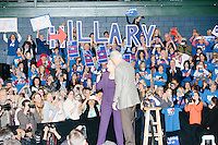"Campaign volunteers hold up large letters spelling ""Hillary"" as former president Bill Clinton embraces his wife, former Secretary of State and Democratic presidential candidate Hillary Rodham Clinton, before she speaks at a rally at Nashua Community College in Nashua, New Hampshire, on Tues. Feb. 2, 2016. Former president Bill Clinton also spoke at the event. The day before, Hillary Clinton won the Iowa caucus by a small margin over Bernie Sanders."