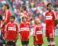 A young Chicago Fire fan stares at Fire defender William Conde (22).  Chicago Fire defeated Toronto FC by the score of 2-1 at Toyota Park stadium, in Bridgeview, Illinois on Saturday, July 12, 2008.
