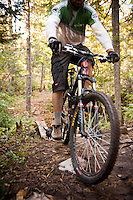 A mountain biker and his dog on the Mango Trail of Copper Harbor Michigan.