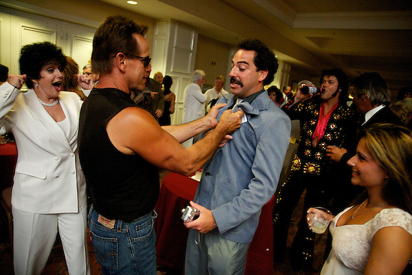 Arnold Schwarzenegger grabs Sacha Baron Cohen Borat impersonator at the Sunburst.Convention of Professional Tribute Artists