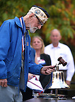 Veteran Charles Sehe rings the original ship's bell during a ceremony at the U.S.S. Nevada Memorial on the Capitol grounds in Carson City, Nev., on Wednesday, Oct. 14, 2015. Sehe served on the U.S.S. Nevada during World War II. <br /> Photo by Cathleen Allison