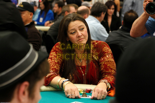 CAMRYN MANHEIM.Arrivals to compete in the 8th Annual World Poker Tour Invitational, with proceeds benefiting non-profit organization Chrysalis. At the Commerce Casino, Los Angeles, CA, USA. .February 21st, 2010.half length red gold top chips table sitting  . CAP/CEL/MR.©Magali Ruer/CelPh/Capital Pictures