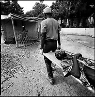 Luanda, Angola, May 20, 2006.A severely dehydrated man is brought to the Cacuaco MSF Belgium operated cholera field clinic. Between February and June 2006, more than 30000 people were infected with cholera in Angola's worse outbreak ever; more than 1300 died.