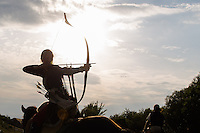 Timea Gal of Hungary takes aim during the European Open Championship of Horseback Archery in Veroce, about 60 km (37 miles) north of the capital Budapest, Hungary on August 31, 2012. ATTILA VOLGYI