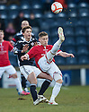 Deveronvale's Craig Cowie clears from Raith's Stuart Anderson ...