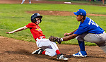 NAUGATUCK , CT-073120JS13—Union City Blue Jays' Ethan Williams (12) tags out Peter J. Foley Cardinals's Gio Scapalleto (12) at third base after he got caught in a run-down during their Little League game at Peter J. Foley field in Naugatuck on Friday. <br /> Jim Shannon Republican-American