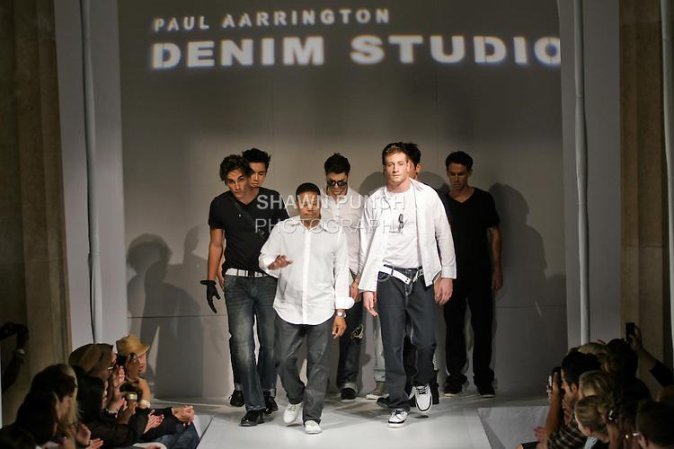 Fashion designer Paul Aarington, walks with models at the close of his the Paul Aarrington Denim Studio Spring 2011 fashion show, during Nolcha Fashion Week, September 14, 2010.