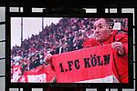 01.12.2018, RheinEnergieStadion, Koeln, GER, 2. FBL, 1.FC Koeln vs. SpVgg Greuther Fürth,<br />  <br /> DFL regulations prohibit any use of photographs as image sequences and/or quasi-video<br /> <br /> im Bild / picture shows: <br /> Feature Stadionbildschirm mit FC Fan und Fahne<br /> <br /> Foto © nordphoto / Meuter