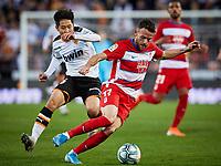 9th November 2019; Mestalla, Valencia, Spain; La Liga Football,Valencia versus Granada; Quino Marin of Granada turns the ball away from Kangin Lee - Editorial Use