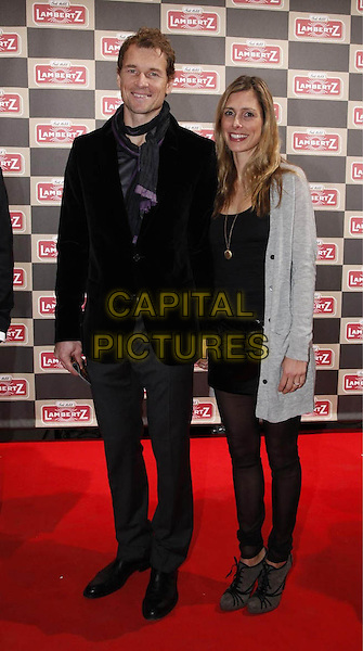JENS LEHMANN & CONNY (WIFE).Lambertz Schoko & Fashion Party, Age .Waiting room, Cologne, Germany..February 2nd, 2009.full length black jacket coat leggings grey gray married husband wife .CAP/PPG/JH.©Jens Hartmann/People Picture/Capital Pictures