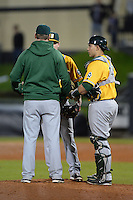 Siena Saints catcher Dan Vasquez (19) listens to coach Michael Keller talk with pitcher Matt Quintana (30) during the season opening game against the Central Florida Knights at Jay Bergman Field on February 14, 2014 in Orlando, Florida.  UCF defeated Siena 8-1.  (Mike Janes/Four Seam Images)