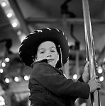 West Mifflin PA:  Michael Stewart riding the Merry-Go-Round at Kennywood Park - 1956.  The Stewart and Panneton families visited Kennywood during the fall of 1956.  Kennywood Park is one of the oldest amusement parks in America, founded in 1898. Kennywood Park was a big part of our childhood in the Pittsburgh area. At the end of each school year, most school districts had a Kennywood Park Day.  The rides included the roller coasters; Jackrabbit, Racer and Thunderbolt along the infamous Old Mill where you could steal a kiss or two.  Kennywood was designated a National Historic Landmark since 1987