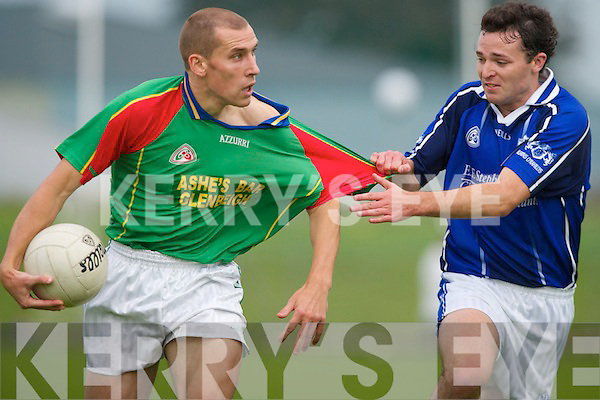At a stretch. Mid Kerry wing forward Sean OSullivan has his shirt tested by tight-marking Kieran Scannell of Kerins ORahillys in their County Championship quarter final match in Tralee on Sunday. .
