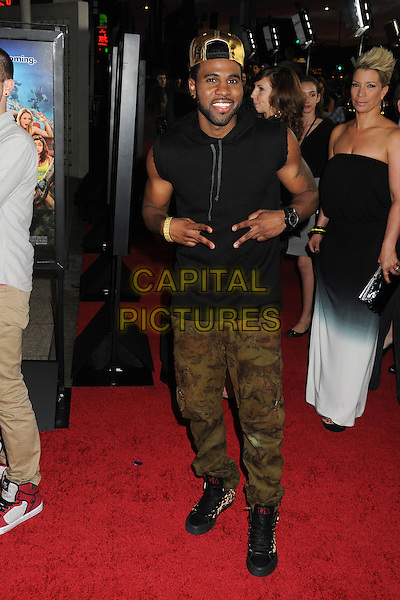 """Jason Derulo.Attending the """"Scary Movie 5"""" Los Angeles film premiere held at the Cinerama Dome,  Hollywood, California, USA, .11th April 2013..full length sleeveless black hoodie hood cap hat camouflage trousers khaki green boots hands gesture gold .CAP/ADM/BP.©Byron Purvis/AdMedia/Capital Pictures"""