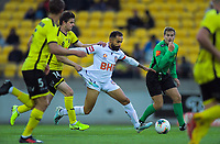 Phoenix's Alex Rufer fouls Perth captain Diego Castro during the A-League football match between Wellington Phoenix and Perth Glory at Westpac Stadium in Wellington, New Zealand on Sunday, 27 October 2019. Photo: Dave Lintott / lintottphoto.co.nz