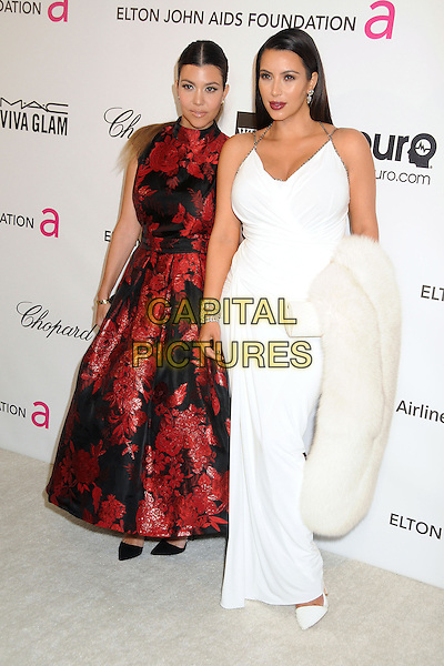 Kourtney Kardashian & Kim Kardashian.21st Annual Elton John Academy Awards Viewing Party held at West Hollywood Park, West Hollywood, California, USA..February 24th, 2013.oscars full length dress white halterneck pregnant carrying fur sisters siblings family red black embroidered floral print .CAP/ADM/BP.©Byron Purvis/AdMedia/Capital Pictures.