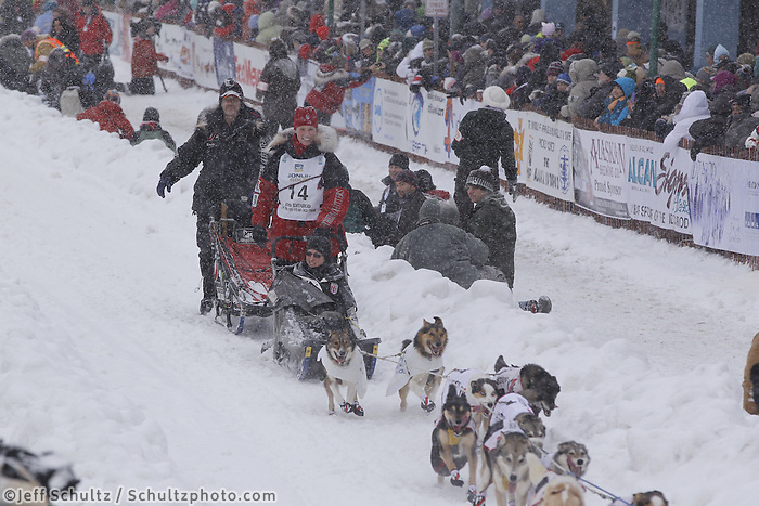 Aliy Zirkle March 3, 2012 Aliy Zirikle waves to the crowd as she leaves down 4th avenue during the Ceremonial Start of Iditarod 2012 in Anchorage, Alaska.