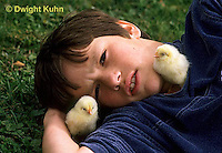 DG08-058x  Child with chicks - newly hatched - fluffy and dry.