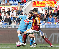 Calcio, Serie A: Roma vs Napoli. Roma, stadio Olimpico, 25 aprile 2016.<br /> Napoli&rsquo;s Gonzalo Higuain, left, is challenged by Roma&rsquo;s Ervin Zukanovic during the Italian Serie A football match between Roma and Napoli at Rome's Olympic stadium, 25 April 2016. <br /> UPDATE IMAGES PRESS/Isabella Bonotto
