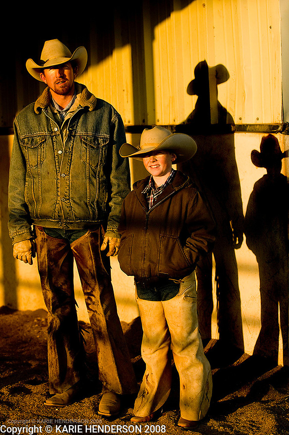 """Justin """"July"""" Johnson, 32, poses for a portrait with his son Riggen Johnson, 9, outside their tack room at the Triangle Ranch stables.  In Paducah, Texas, Thursday, Feb. 21, 2008. (Photo by, Karie Henderson © 2008)"""