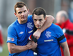 Lee McCulloch and Chris Hegarty at the end of the match with their black armbands